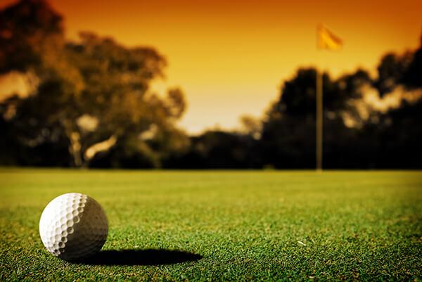 golf-ball-on-green-sunset